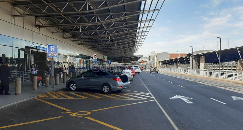 Drop-off zone at O R Tambo International Airport in South Africa. Johannesburg, South Africa - November 13, 2019: unidentified passengers in the drop off zone at royalty free stock photos