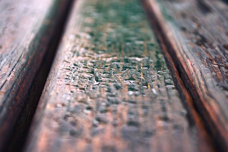 Drop of rain on wooden boards stock photography
