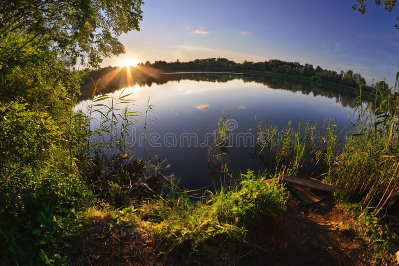 Drop-Sea. Summer sunset on the shore of the pond. Dnepropetrovsk. Ukraine stock image