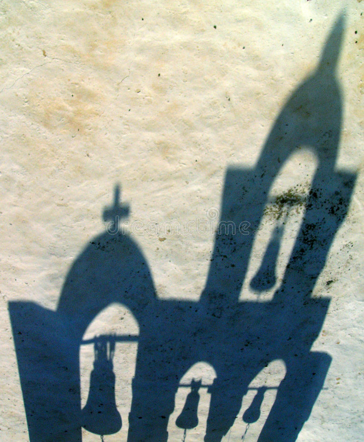 Drop shadow. Of chapel in Oia in Santorini in Greece stock photography
