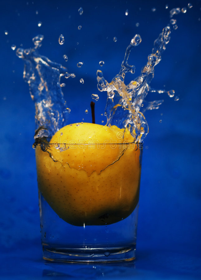 Download Drop to glass of water stock photo. Image of apple, yellow - 3255006