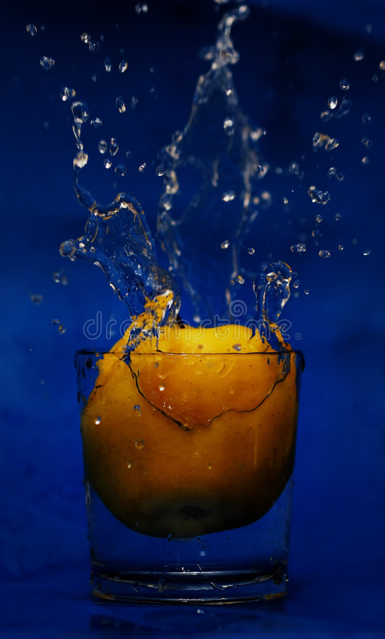Drop to glass of water royalty free stock photo