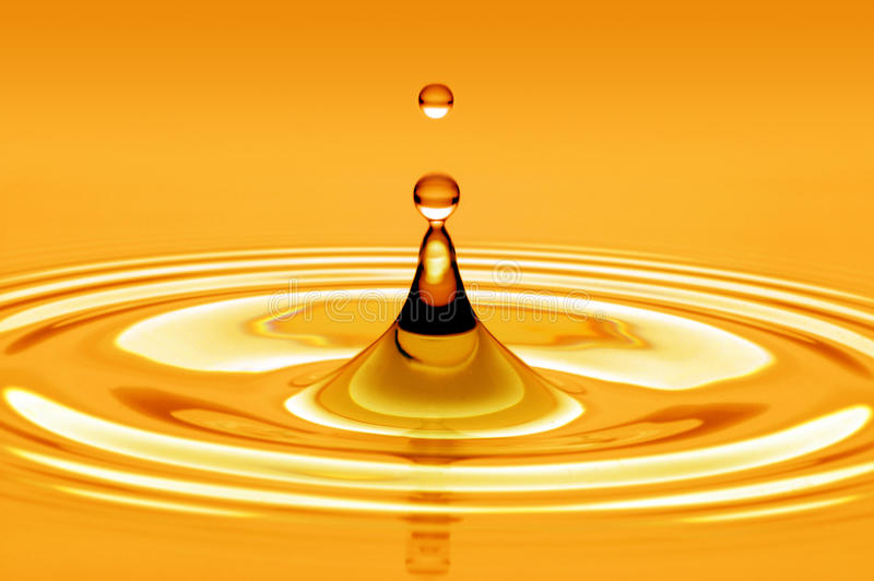 Drop of water gold. Power- Drop of water gold royalty free stock photos