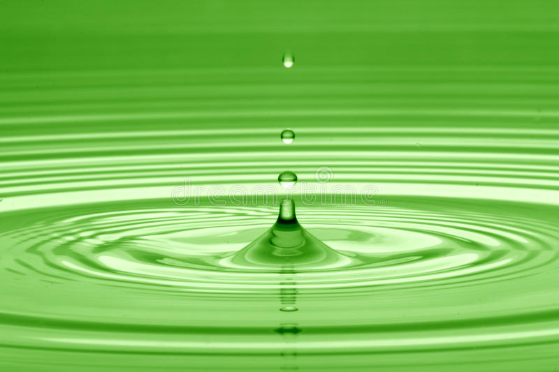 Drop of water in green stock images