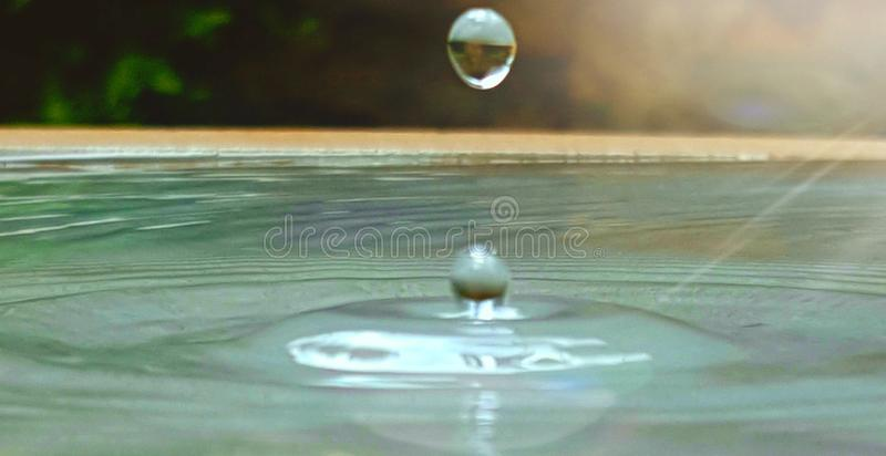 A drop of water hitting water royalty free stock photo