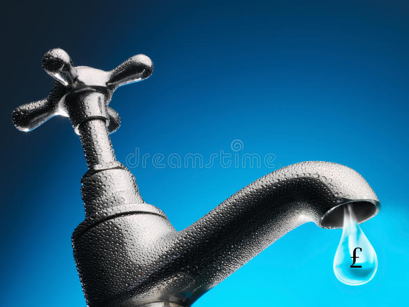 Drop of water trickling from tap close-up.  royalty free stock images