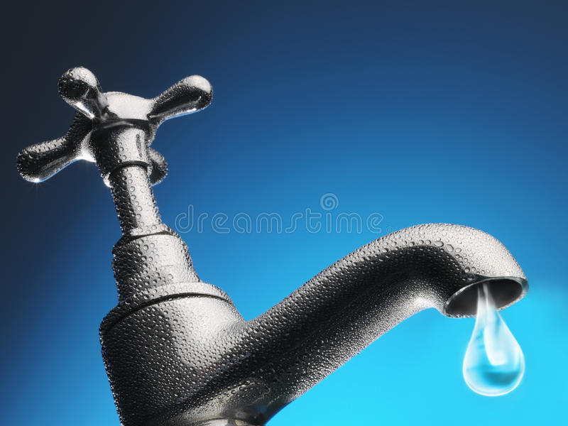 Drop of water trickling from tap close-up (digital composite) stock images