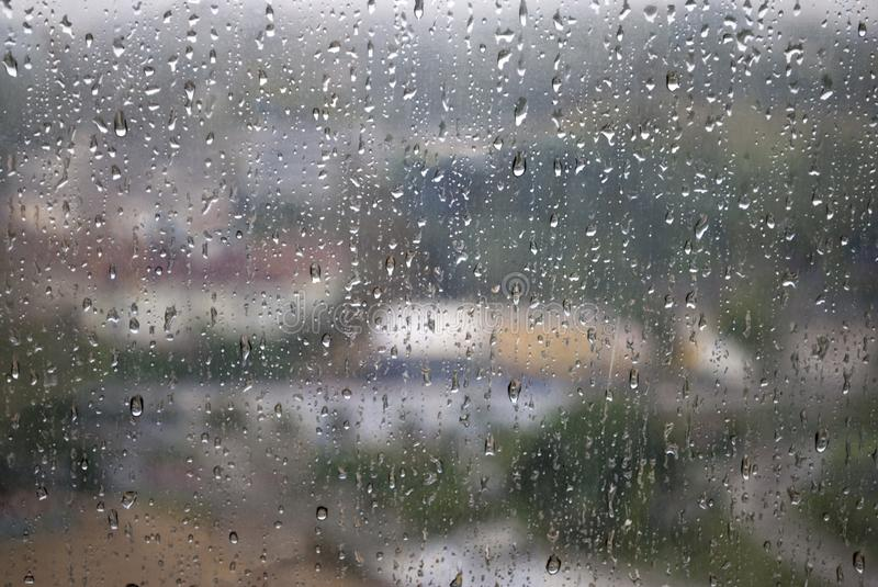 drop of water on window glass during raining day stock image image