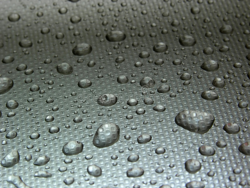 Droplets on metal stock images
