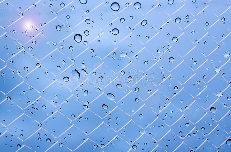 Droppar och solljus för regn för himmel för rastermodeller royaltyfri bild