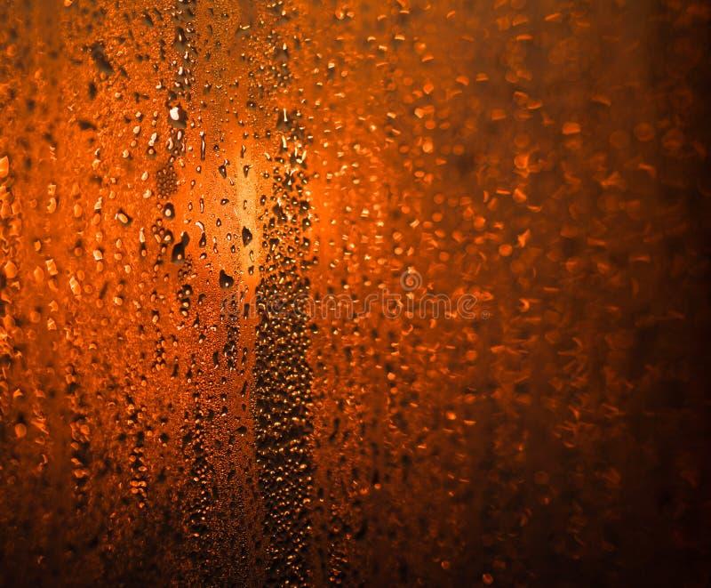 Dropparna på glass bokeh royaltyfria foton