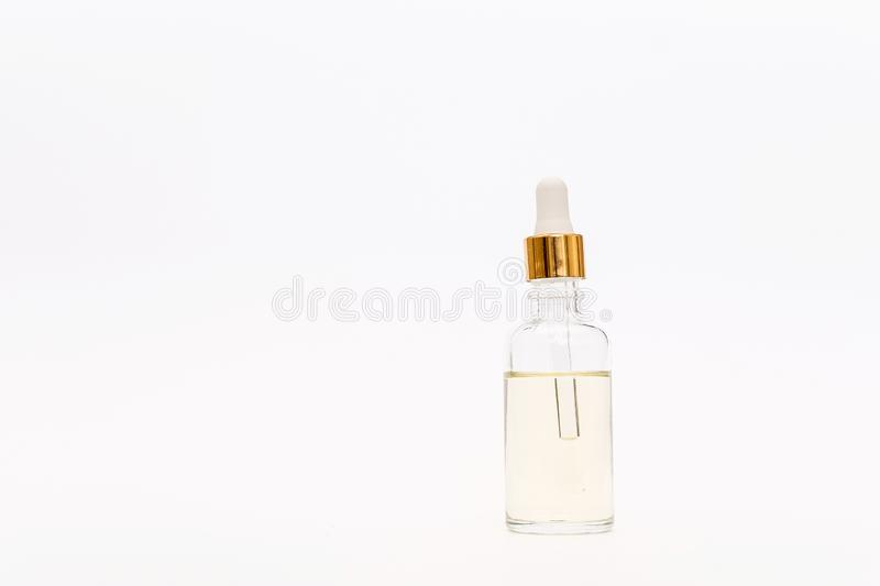 Dropper glass Bottle Mock Up. Cosmetic pipette on white background stock images