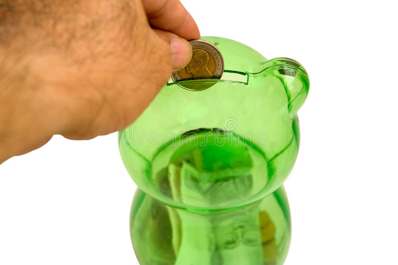 Drops a coin bank.2. The savings accumulated by little to get to the goal stock photos