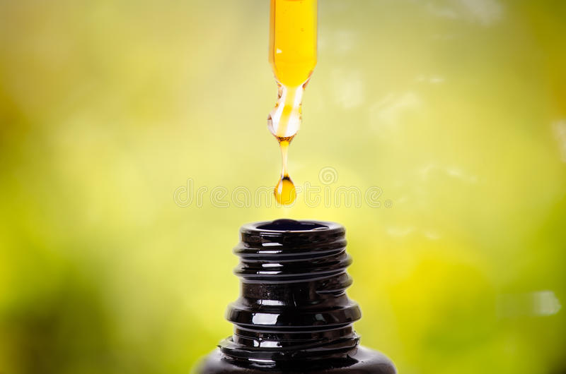Drops from a dropper in a bottle. Isolated on a white background. Pharmacy and healthy background. Medicine. . stock photos
