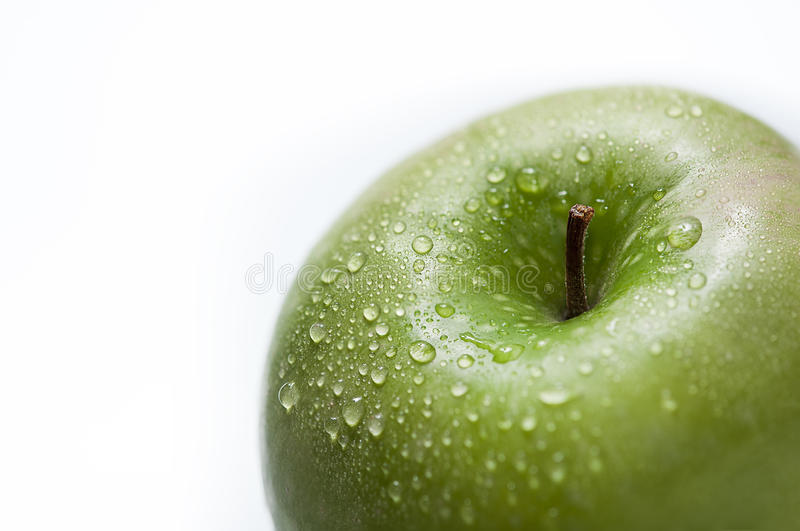Drops on a green apple stock images