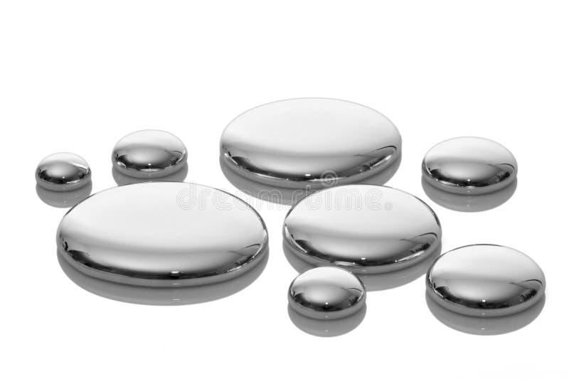 Drops of mercury on white. Very sharp. royalty free stock photos