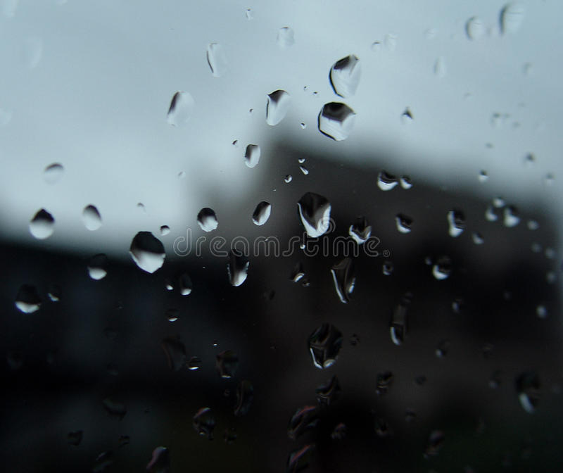 Drops of rain. Close up of rain drops on a window stock photography