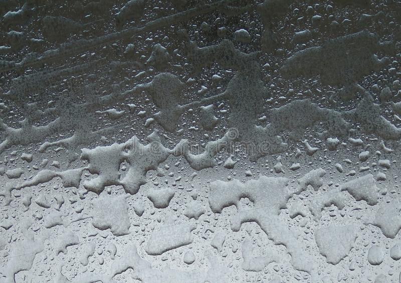 Drops Of Rain Water On Metal Surface Background - Close up shiny metal surface covered in water droplets after the rain royalty free stock photography