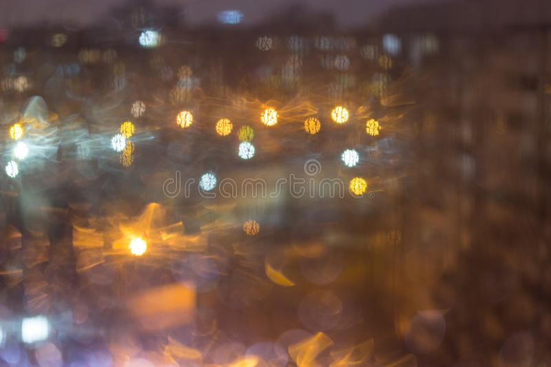 Drops of rain on window, night. Blurred light royalty free stock photography