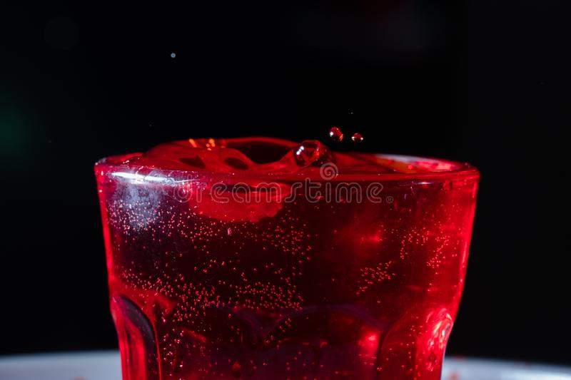 Drops of red liquid. In glass beaker, abstract, alchemy, alcohol, assets, backdrop, background, banner, bar, beautiful, beauty, berry, beverage, blob, blood stock photography