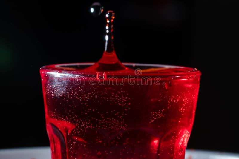 Drops of red liquid. In glass beaker, abstract, alchemy, alcohol, assets, backdrop, background, banner, bar, beautiful, beauty, berry, beverage, blob, blood royalty free stock photo
