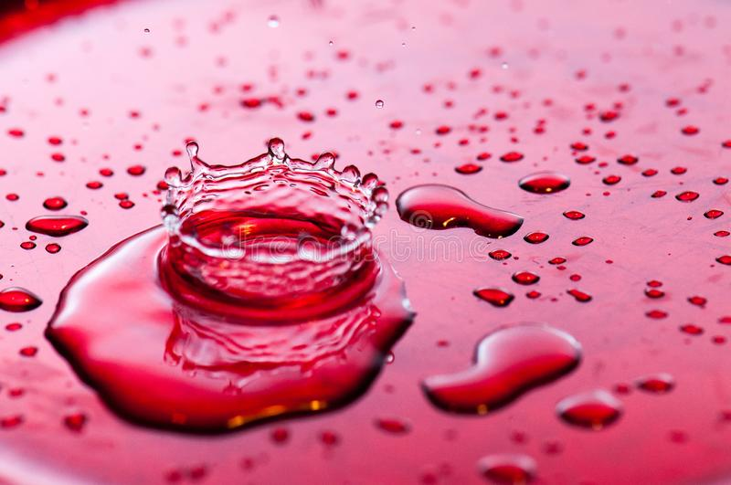 Drops in a splash with transparent effects royalty free stock photos