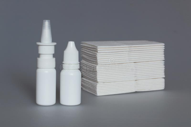 Nasal drugs, spray and handkerchiefs. Drops, sprays, medical forms for the treatment of rhinitis, dosage and non-dosed forms of drugs for the treatment of people stock photos