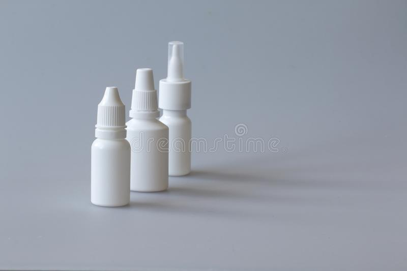 Nasal drugs, spray and handkerchiefs. Drops, sprays, medical forms for the treatment of rhinitis, dosage and non-dosed forms of drugs for the treatment of people royalty free stock photography