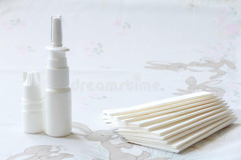 Nasal drugs, spray and handkerchiefs. Drops, sprays, medical forms for the treatment of rhinitis, dosage and non-dosed forms of drugs for the treatment of people stock image