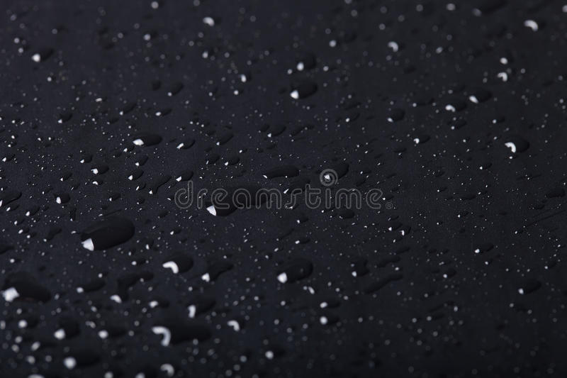 Drops of water on a color background. Shallow depth of field. Se. Lective focus royalty free stock image