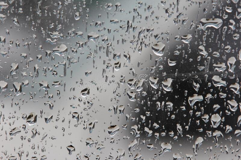 Drops of water on glass after rain royalty free stock photos