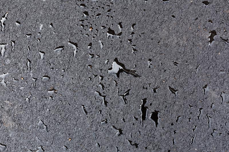 Drops of water on the pavement stock image