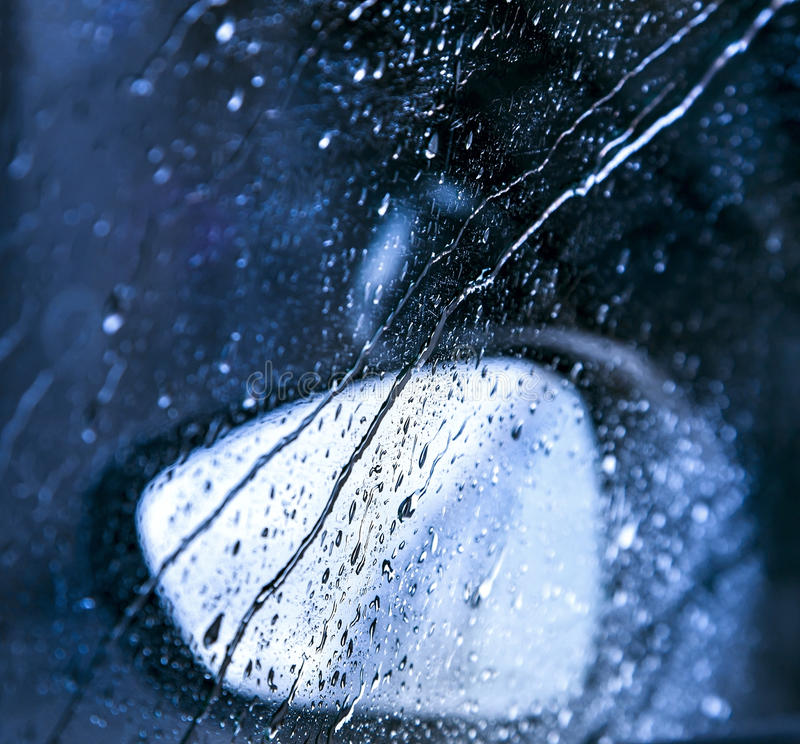 Drops on the window in rain stock photos