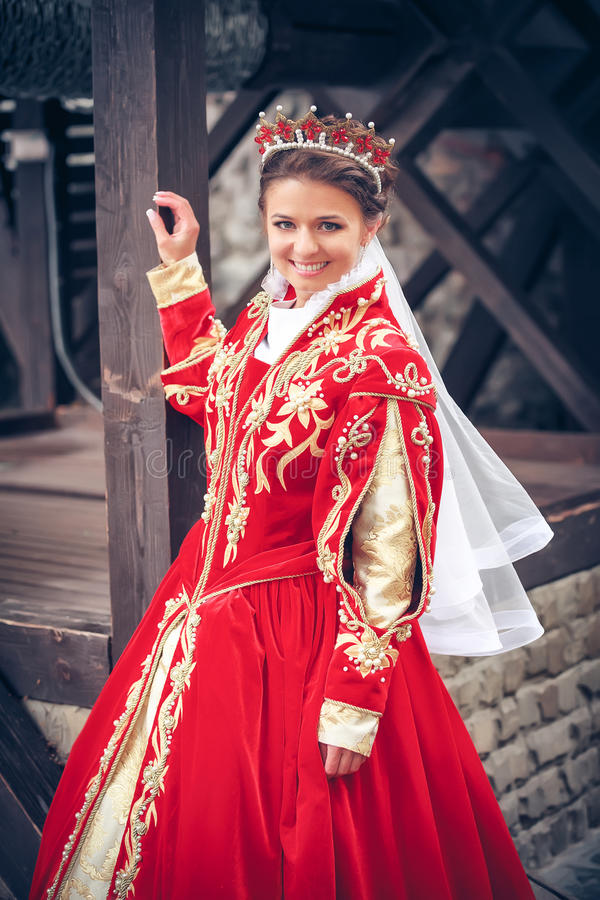 Drottning i den röda klänningen arkivfoto