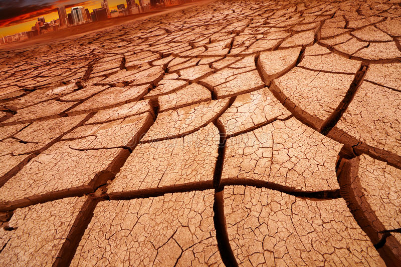 Drought. Concept, landscape with city and cracked land royalty free stock images