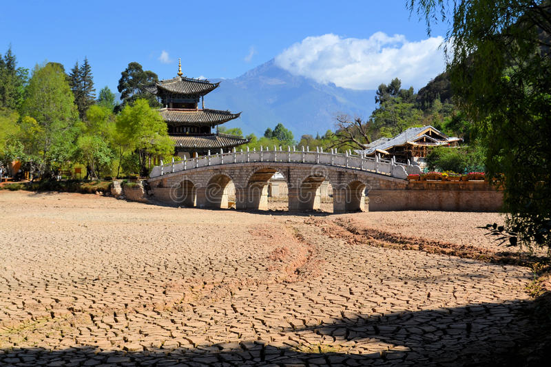 Drought in China, soil cracks, global warming. During a drought in China, cracks in the soil are showing in a river bed due to global warming royalty free stock photo