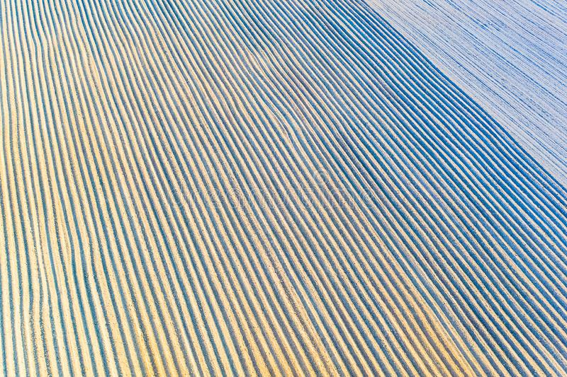Drought concept. Ecological problem on farmlands. Ploughed soil, aerial landsdcape. Rows on soil stock image