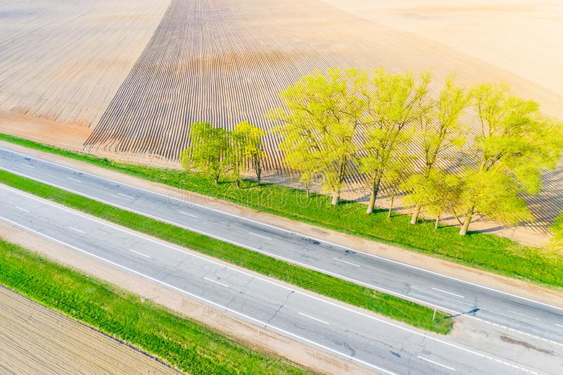 Drought concept. Road running along farmlands, aerial landscape. Drought concept. Road running along the farmlands, aerial landscape. Transportation concept royalty free stock images