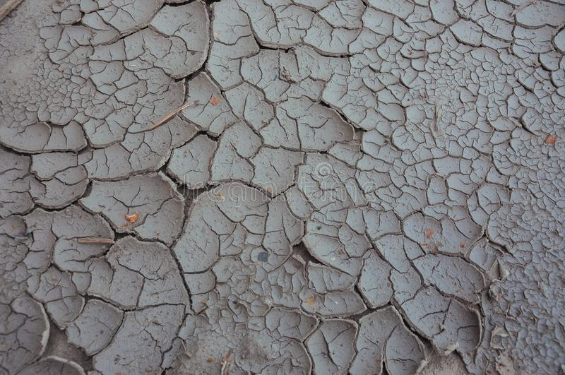 Drought, the ground cracks, no hot water, lack of moisture. Cracked ground. Drought, the ground cracks, no hot water, lack of moisture. Dried and Cracked ground royalty free stock image