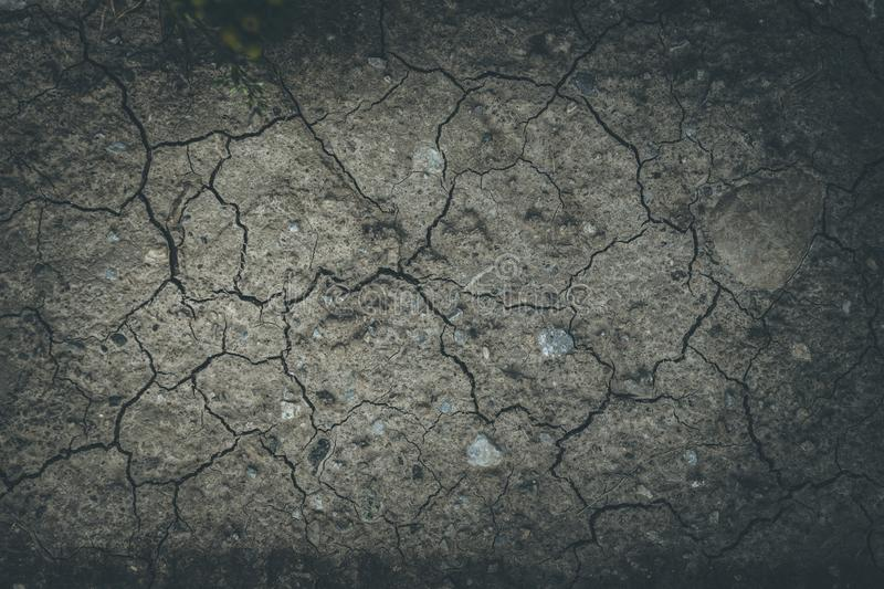 Drought in summer: fractured ground on an agriculture field. Dry ground: water shortage in hot summer, agriculture desert earth dirt soil drought background stock photography