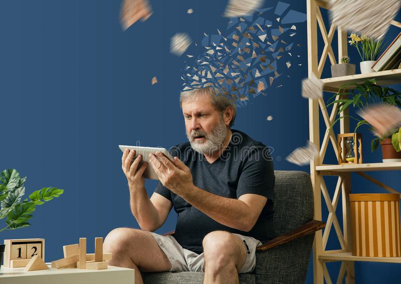 Old bearded man with alzheimer desease. Drown image of losing of mind. Old bearded man with alzheimer desease has problems with his hands motor skills. Illness stock photos