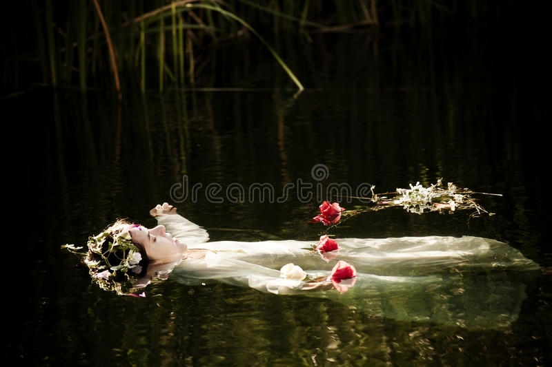 Drown woman. Young drown woman in a poetic representation stock image