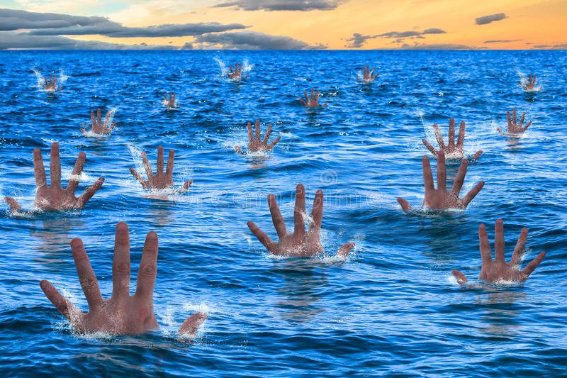 Drowning. Hands of a men sinking and drowning in the sea. Business concept failed, bugdet not reached, bankruptcy risk company, concept drowning, bankruptcy royalty free stock photography