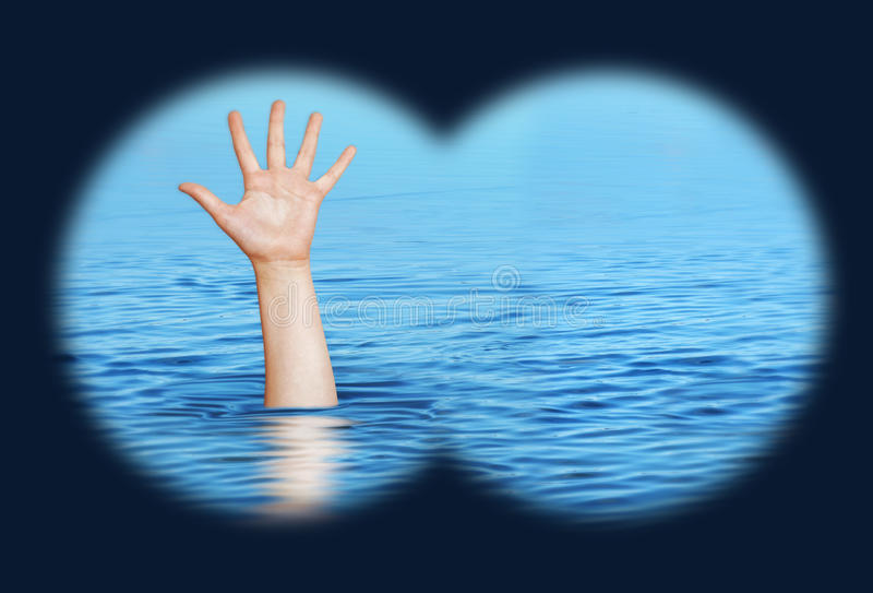 Drowning man needs help. View through binoculars royalty free stock photo