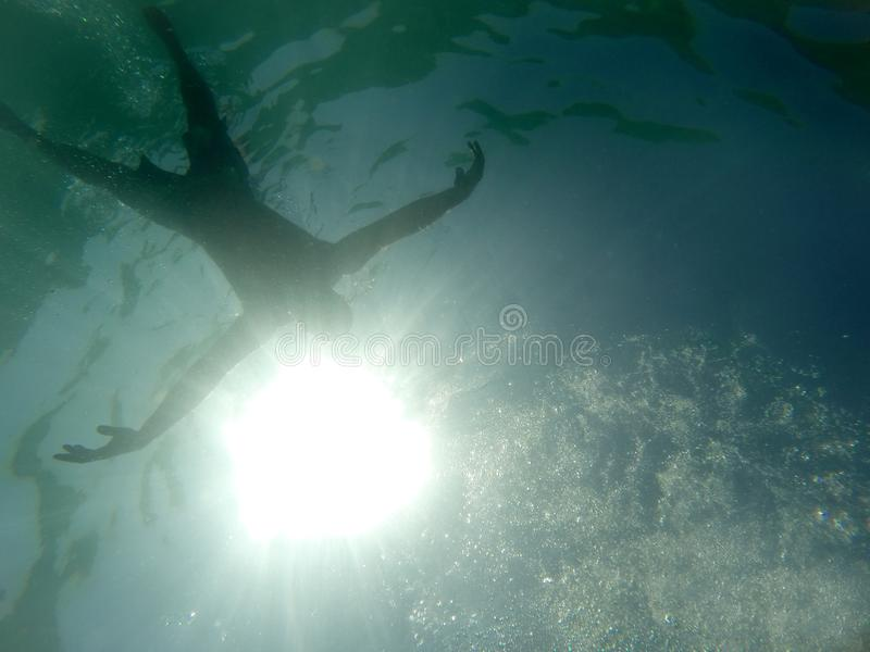 Drowning man in the sea royalty free stock photography