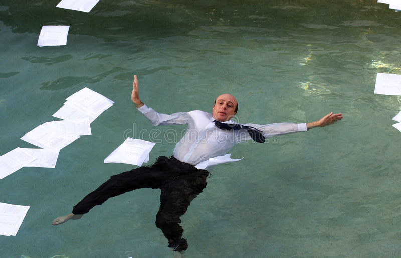 Drowning in paperwork stock photo