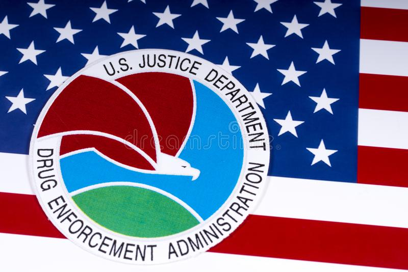 Drug Enforcement Administration Seal and US Flag. LONDON, UK - MARCH 27TH 2018: The seal or symbol of the Drug Enforcement Administration of the US Justice stock photography
