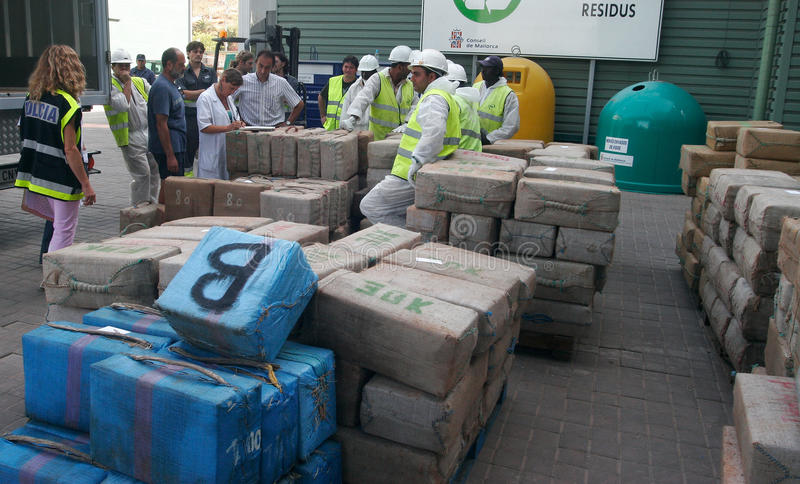 Drug packs are stacked and shown to medias before its destruction. Police workers retrieve and range packs of drugs before proceeding to its incineration after royalty free stock image