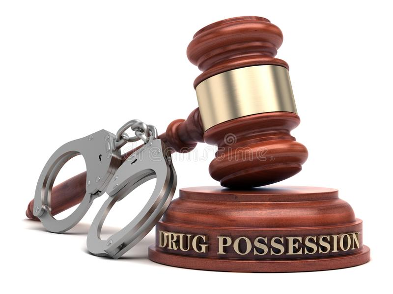 Drug Possession. Text on sound block and handcuffs royalty free stock images