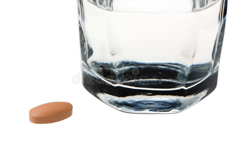 Download Drug Tablet In Front Of Glass Of Water Stock Photo - Image: 7930476